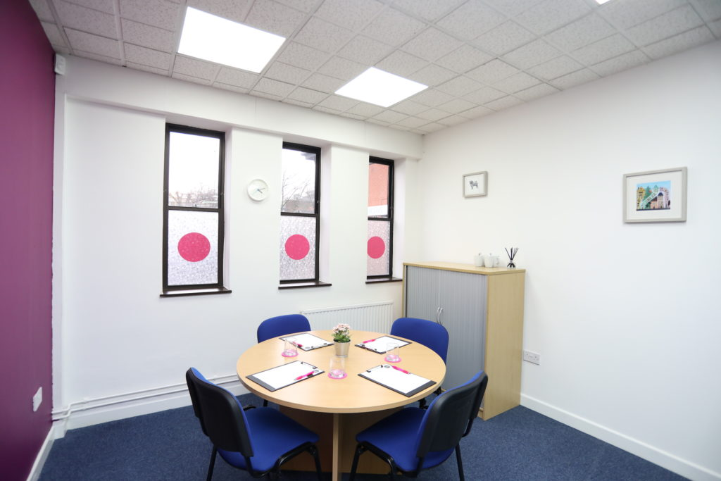Co*Shabang Gateshead Small Meeting Room with one round table and 4 chairs, for Co-working, Co-sharing, Office & Meetings Rooms.  Car Park View
